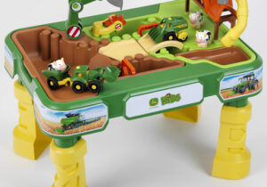 John Deere Farm-Sand and Water Play Table: Great farm play fun with agricultural vehicles, cows and cow barn. Play table consists of basins for sand and water with drawbridge, water bulkheads, water wheel and small planting basin. Suitable for children 18 months +