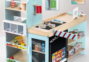 Wooden Supermarket-shopping like mom&dad: With lots of storage space, including wooden play food and miniature sales packaging, food chutes, counter as cashier area with drawer, chalkboard for individual labelling, barrier to close and open, goods conveyor belt with goods separator.
