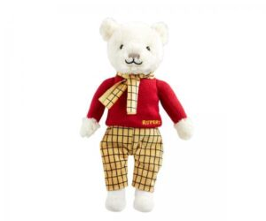 Everyone knows Rupert Bear and this lovable Rupert Bear Soft Toy, wearing his famous knitted red jumper embroidered with Rupert and iconic yellow checked trousers with matching scarf, makes a wonderful gift for any fan of this much-adored bear.