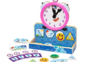 Clock hands turn to match activity cards. Includes feeling, weather, season and daily activity magnets. Spinning temperature dial. Night and day wooden flap.