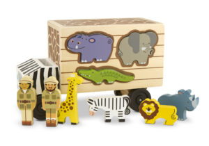 With this safari shape-sorter truck, two rangers are ready to zoom across the savannah to help their animal friends! The alligator, zebra, rhinoceros, elephant, giraffe and lion all fit into the sides of the wooden truck.