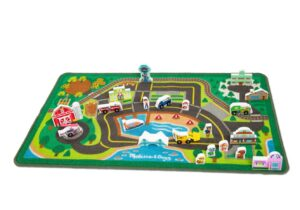 Themed after Adventure Bay. Double-sided wooden figures, buildings, cars and street signs. The soft rug is machine washable, features skid-proof backing and reinforced border binding.