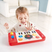 Help your little ones spin their first tunes with this portable DJ studio! Play the keyboard solo with one of four instrument sounds or 18 fun sound effects or you can start one of five background tunes and use the tempo slider to change the speed, add DJ sound effects as well as scratching along with the black record!